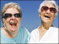Two older women laughing together. Credit: Age Concern