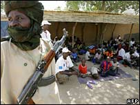 A Chadian soldier guards an orphanage serving as the temporary home for 103 children at the centre of the row. File photo