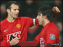 Carlos Tevez is congratulated after putting Manchester United 2-0 ahead