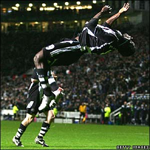 Obafemi Martins celebrates scoring a penalty for Newcastle