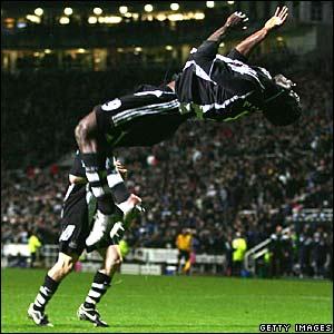 Obafemi Martins celebrates scoring a penalty for Newcastle