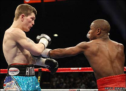 Hatton is punched by Mayweather