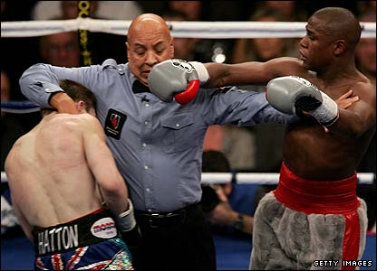 The referee splits the fighters up
