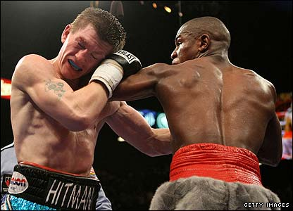 Hatton holds on as Mayweather dominates