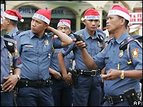 Manila police with Santa Claus hats - 5/12/2007