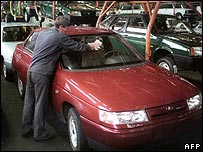 Worker cleaning a Lada model at the Togliatti factory
