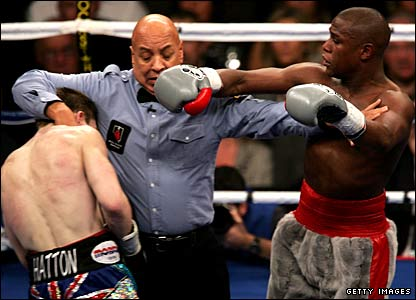 Referee Joe Cortez attempts to separate Ricky Hatton and Floyd Mayweather