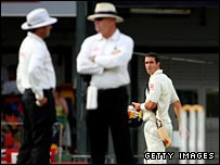 The umpires confer as Pietersen walks off