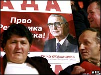 Bosnian Serbs at rally with poster of Rajko Kuzmanovic