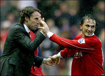 Tuncay Sanli celebrates with Gareth Southgate