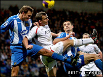 Bolton's Kevin Davies challenges for the ball in the air