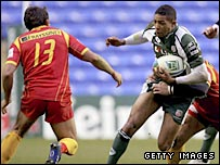 London Irish centre Delon Armitage takes on the Perpignan defence