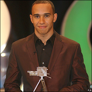 Lewis Hamilton collects his award