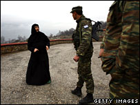 KFOR soldiers patrol the ethnic Serb Zakonice monastery in Kosovo
