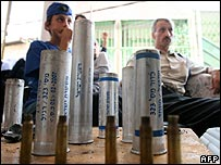 Arab residents of Pekiin in northern Israel sit in front bullet and gas cases fired by Israeli police after riots in October 2007