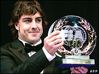 Fernando Alonso holds his trophy for third place in the world championship in 2007 at the FIA annual awards ceremony