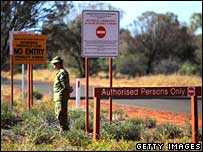 An Australian soldier at the entrance to an Aboriginal community in the Northern Territory - file photo