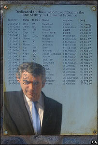 Gordon Brown reflected in a plaque to soldiers who have died in Helmand