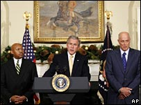 President Bush, flanked by Alphonse Jackson ( left) and Henry Paulson (right)