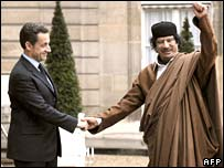 French President Nicolas Sarkozy with Libya's Col Muammar Gaddafi at the Elysee Palace in Paris on Monday