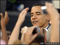 Supporters applaud Barack Obama at a rally in South Carolina