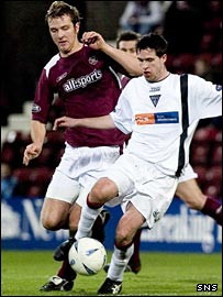 Stephen Bradley is challenged by Hearts' Andy Webster