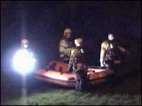 Rescuers searched well into the night for the missing woman