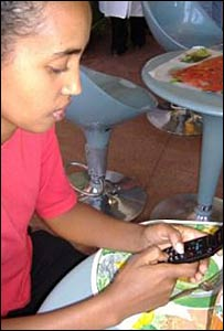 Ethiopians texting in Amharic on her mobile phone