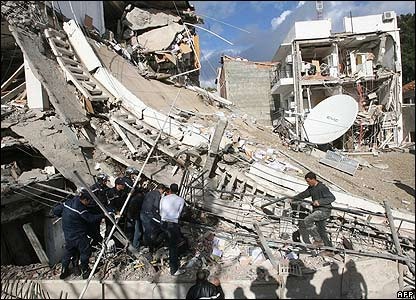 Rescuers search for survivors in the rubbles of a destroyed building close to the UN offices