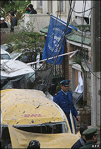 UN flag outside bombed building in Algiers