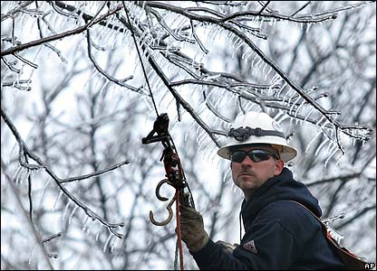 A worker tries to restore power supplies in Wright City, Missouri