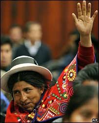 A member of the assembly raises her hand to back the proposals