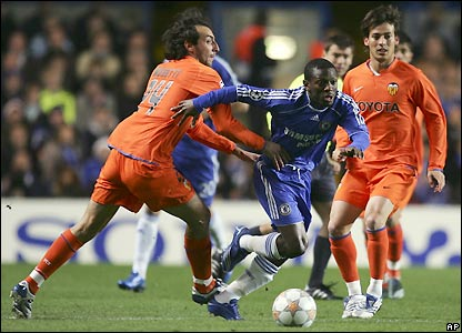 Emiliano Moretti attempts to stop Shaun Wright-Phillips