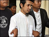 Abu Dujana arrives in court, 12th Dec