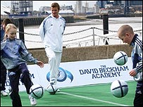David Beckham watches on as kids practice at his academy in London