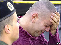 Lebanese soldier mourns Gen Francois al-Hajj, Beirut