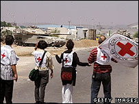 Red Cross workers in Gaza try to secure an ambulance for an injured Palestinian