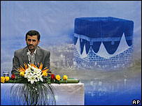 President Ahmadinejad in front of a picture of the Kaaba in Mecca