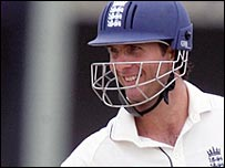 England captain Michael Vaughan smiles after reaching his fifty