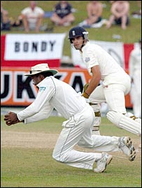 Sri Lanka captain Mahela Jayawardene holds the catch to remove Alastair Cook in Colombo