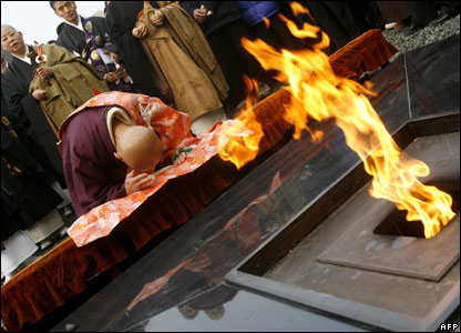 Monk prays before an altar in Nanjing