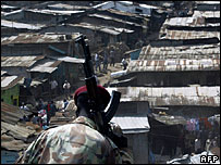 A soldier looking down over Mathare slum in Kenya