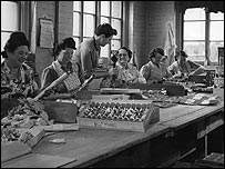 Women assemble crackers in a British factory in the late 1940s