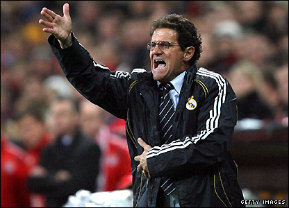 Capello waving instructions from the touchline