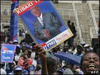 Man holding poster for President Mwai Kibaki