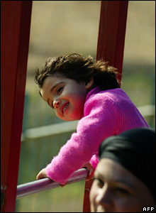 A girl enjoys riding an electric train at al-Zawraa Park in the Iraqi capital, Baghdad.