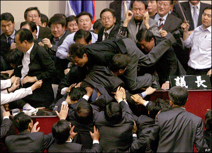 Members of the United New Democratic Party attempt to end a sit-in by the opposition Grand National Party in the South Korean parliament in Seoul.