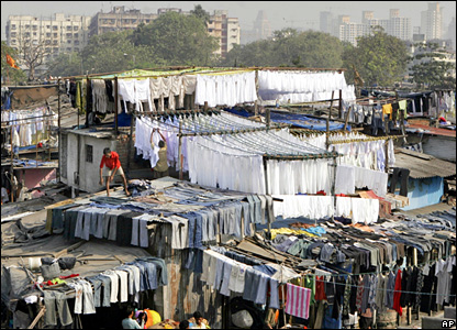 Laundry men hang up clothes to dry at the Dhobighat, the world's largest outdoor laundry, in the Indian city of Mumbai.