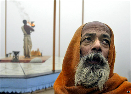 Hindu holy men pray on the banks of the River Ganges in the northern Indian city of Varanasi