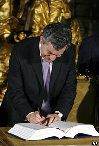 Gordon Brown signs the EU reform treaty